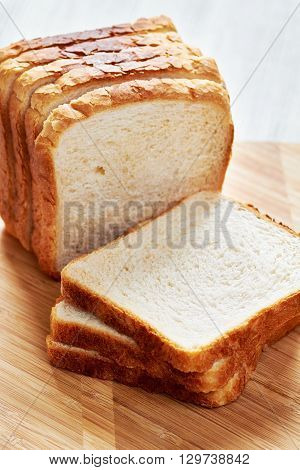 Slices of bread for toasting on a cutting board