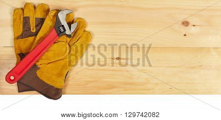Wrench And Gloves Wrench On Wooden Background