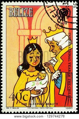 MOSCOW RUSSIA - MAY 14 2016: A stamp printed in Belize shows Queen with her daughter and King - scene from a fairy tale