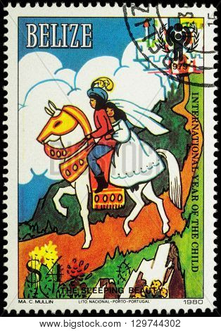 MOSCOW RUSSIA - MAY 14 2016: A stamp printed in Belize shows Prince and princess at horse - scene from a fairy tale