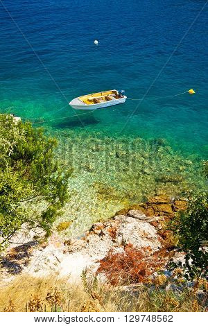 Lonely boat on idyllic beach island of Dugi Otok Croatia poster