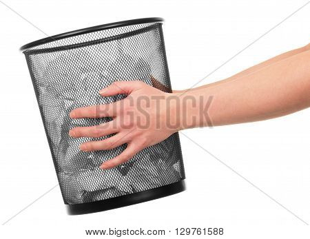 Women's hands are holding a bucket with paper isolated on white background.