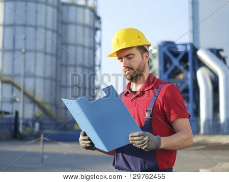 engineer worker with helmet at work outside factory