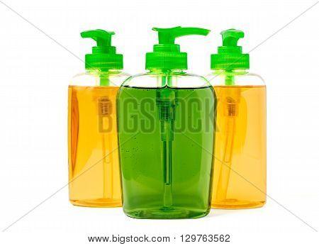 Three liquid soap dispenser plastic bottles isolated on white
