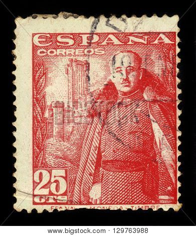 SPAIN - CIRCA 1950: a stamp printed in the Spain shows General Franco, Caudillo of Spain in front of the Castle of La Mota, red, circa 1950