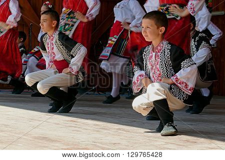 ROMANIA TIMISOARA - JULY 12 2015: Child and youths from Bulgaria in traditional dress presented an specific dance at a international folk dance festivalduring International Festival of hearts