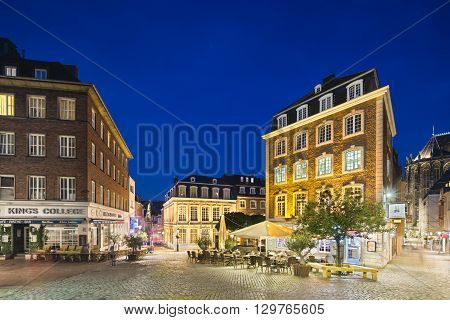 AACHEN Germany - AUGUST 02: Restaurants and the Couven-Museum next to the old town hall of Aachen Germany with night blue sky. Taken with a shift lens on August 02 2015