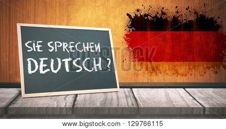 sie sprechen deutsch against germany flag in grunge effect