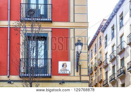Madrid Spain cityscape. Street sigh in Square Isabel II (Plaza de Isabel II) in Madrid Spain.