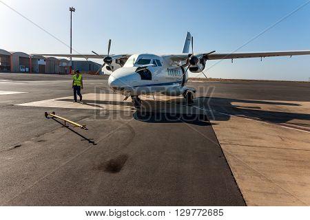 SAO VICENTE, CAPE VERDE - DECEMBER 12, 2015: Small local propeller powered passenger aircraft Cesaria Evora Airport. Cabo Verde Africa