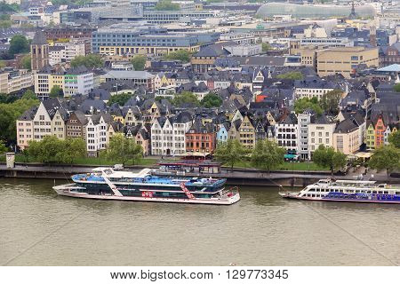Cologne, Germany - May 17: This is old region of town where Cologne River Station and the waterfront Frankenwerft May 17, 2013 in Cologne, Germany.