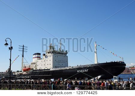 ST. PETERSBURG, RUSSIA - MAY 2, 2016: People waiting in line on English embankment for visit the icebreaker Mudyug during 3rd Icebreaker Festival. It's unique fest dedicated to icebreaker fleet