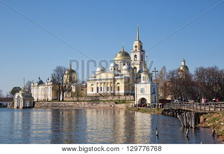 Nilov Monastery on Stolobny island on Lake Seliger. Nilo-Stolobensky. People go to church. Russia.