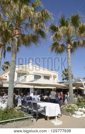 MARBELLA, SPAIN -APRIL 9, 2016: People having lunch at the terrace of a restaurant in the beach of Marbella a city in southern Spain Spain