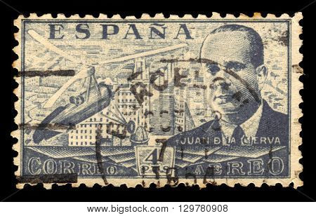 SPAIN - CIRCA 1939: A stamp printed by Spain, shows Juan de la Cierva and Autogiro, was a Spanish civil engineer, pilot and aeronautical engineer, gray, circa 1939