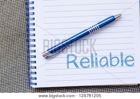 Reliable text concept write on notebook .