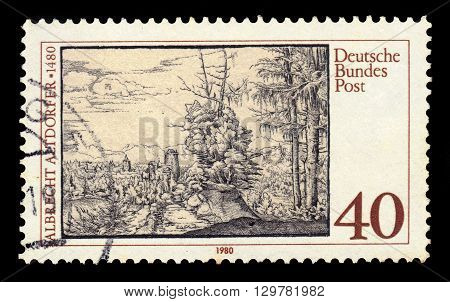 GERMANY - CIRCA 1980: a stamp printed in Germany shows landscape with fir trees by Albrecht Altdorfer, german painter and engraver, circa 1980