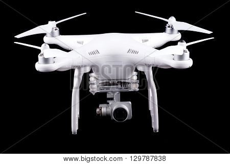 Unmanned aerial vehicle, drone on isolated background, quadrocopter designed for photo and video shooting. White quadrocopter camera.
