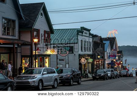 BAR HARBOR - JULY 9: Maine Street with tourist enjoying nice evening  in down town on July 9, 2013 in Bar Harbor, Maine.