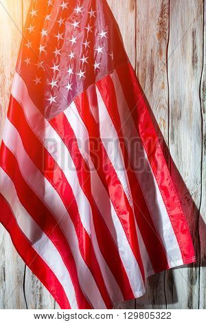 American flag on wooden background. Flag of United States. Banner in the sunlight. Land of opportunity. poster