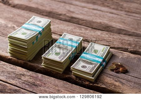 Dollar bundles and coins. Stacks of coins and banknotes. All that's left. Make a wise choice.