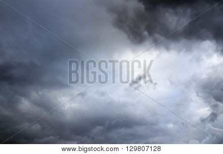 Stormy sky rain. Dramatic thunderclouds over horizon dark gray.