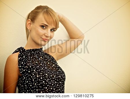 Portrait of an attractive young woman standing with crossed arms.