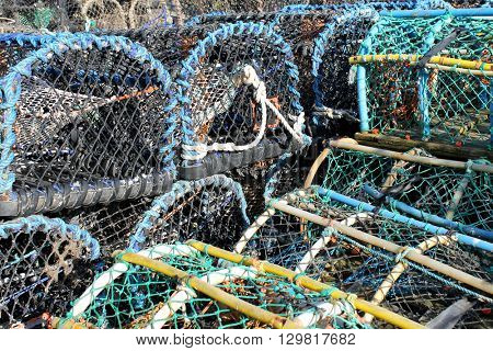 Stack of lobster pots and creels in Scarborough harbor.