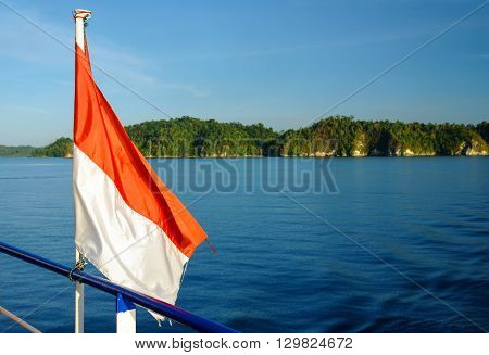 Indonesian flag on the ferry. Togean Islands or Togian Islands in the Gulf of Tomini. Central Sulawesi. Indonesia