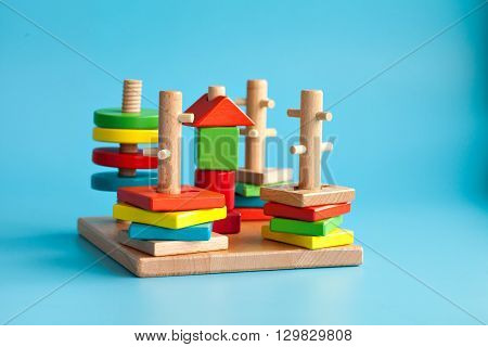 Education and a game for kids. Colorful wooden toys to teach children logic. Motor development. Montessori School.