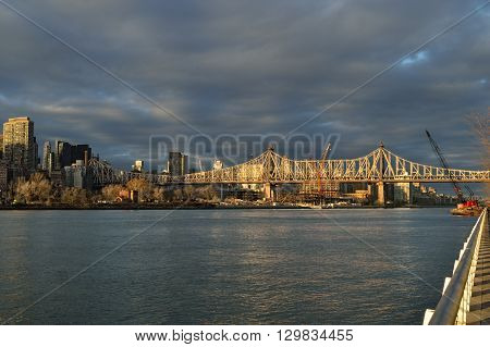 Sunset view of the Queensboro Bridge from the Roosevelt Island.