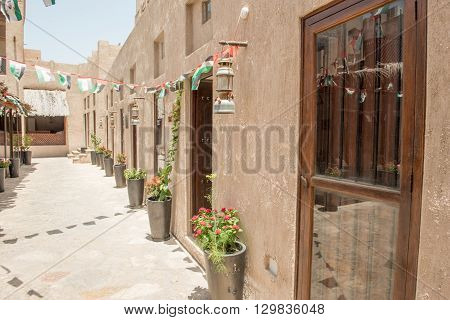 DUBAI - MAY 05 2016: Street of Deira area on a sunny day. Dubai attracts 15 million visitors annually.