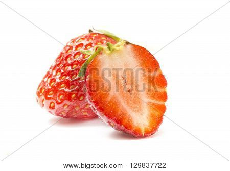 Red berry strawberry isolated on white background. Strawberry isolated on white. Sweet strawberries. Food for health. Slices of strawberry on white. Juicy strawberries for packaging. Eco-friendly food poster