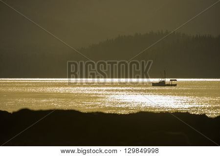 Beautiful Alaskan fishing boat out on the water catching fish