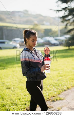 Portrait Of A Runner Hispanic Woman With A Bottle Of Water