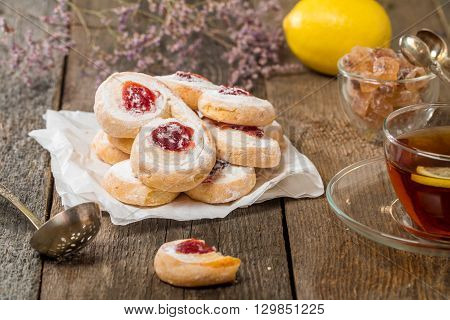 homemade jelly cookies puff pastry with red jam on wooden background