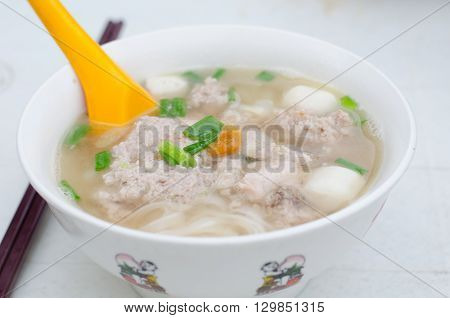 Penang hawker delight - Koay Teow Th'ng (flat rice noodles served in a clear soup broth topped with fish balls minced pork and chicken)