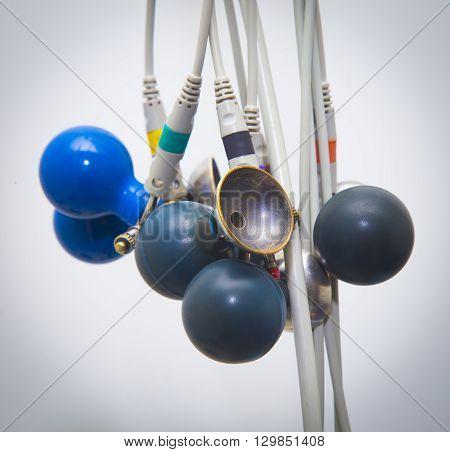 Blue ECG suckers hanging. ECG Medical accesssories