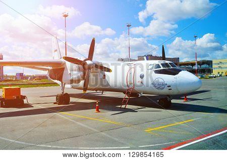 SAINT PETERSBURG RUSSIA - MAY 11 2016. Pskov Avia Airlines Antonov An-24PB airplane -registration number RA 26086- is parked at Pulkovo International airport