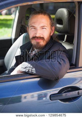 Positive Asian Man As A Driver Of Modern Car