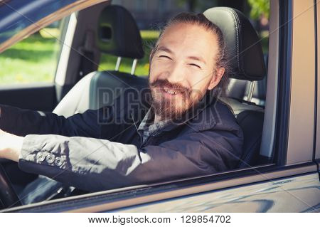 Smiling Asian Man As A Driver Of Modern Suv