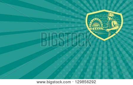 Business card showing illustration of a baker pizza maker holding a peel with pizza pie into a brick oven viewed from side set inside shield done in retro woodcut style.