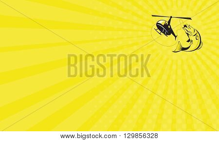 Business card showing illustration of helicopter heli fishing reeling a jumping barramundi or Asian sea bass (Lates calcarifer) on isolated background done in retro style.