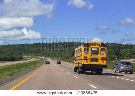 NOVA SCOTIA CANADA - 28TH AUGUST 2014: School Bus and rural roads in Nova Scotia Canada during the day.