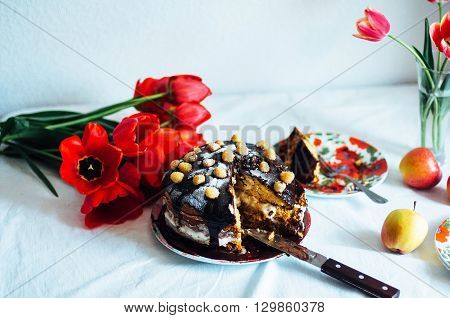 Piece Of Cake With Chocolate Glaze And Raspberries On Plate On W