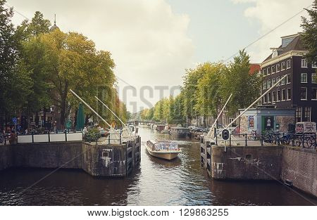 14 September 2014 a tour boat passes the lock on the Singel canal in Amsterdam The Netherlands