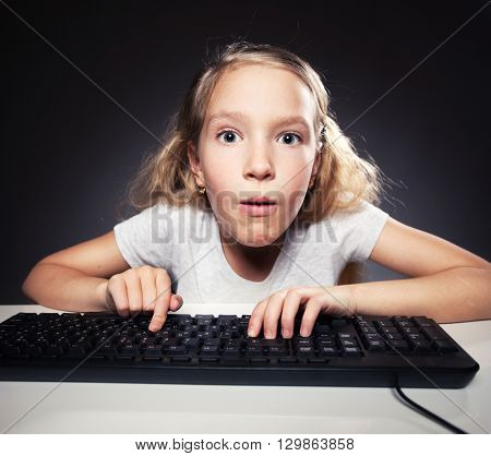Child looking at a computer. Computer addiction