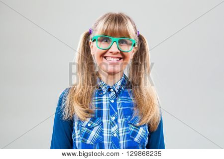 Studio shot portrait of happy nerdy woman