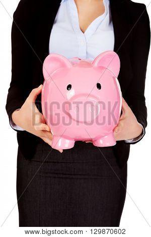 Young business woman holiding piggybank