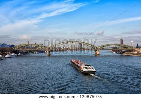 Barge swims to the Hohenzollern Bridge over the Rhine Cologne Germany